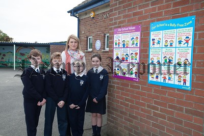 Some of the School Council at St Mary's PS Barr who designed new poster for playground rules are pictured with Miss King. R174102