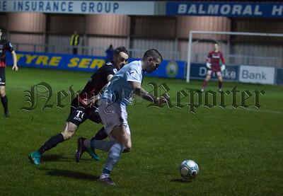 Warrenpoints Darren Murray tries to get past Ballinnamallard's Jay McCartney. RS1742006