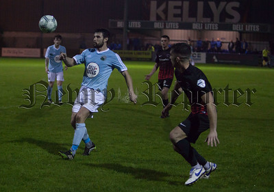 Warrenpoint's Alan Davidson who scored the winning goal on Friday night goes up against Ballinnamallard's Johnny Leddy. RS1743007