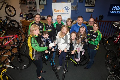 Camlough cycling club cheque presentation to SANDS Noah's charity as part of sands NI for Daisy Hill Hospital. Pictured with club members are Nichola Freer ,Paul Spencer Chloe and Mya . The money was raised through a  Hog Run held in Camlough and raised  £1515.Thanks to JMC cycles Dromintee. RS1742005