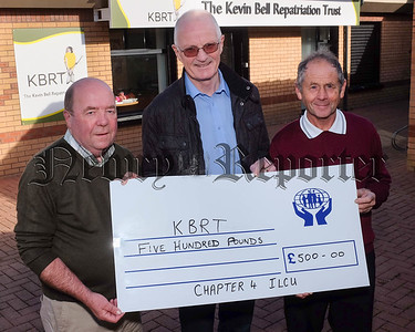 Chapter  4 Irish League of Credit Union's raised £1000 at a recent fundraising barbecue in Gosford Forest Park. The money was divided between Kevin Bell Repatriation Trust and Southern Area Hospice. Colin Bell, left,  is pictured receiving the cheque on behalf of KBRT from John Corrigan and Brian O'Hare, Chapter 4. Photograph: Columba O'Harek