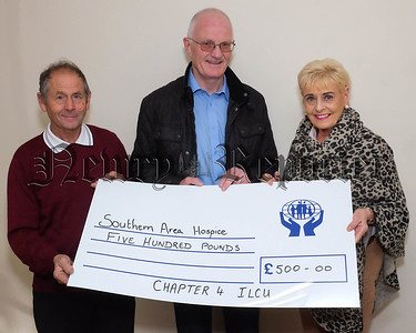 Chapter  4 Irish League of Credit Union's raised £1000 at a recent fundraising barbecue in Gosford Forest Park. The money was divided between Kevin Bell Repatriation Trust and Southern Area Hospice. Geraldine Lambe is pictured receiving the cheque on behalf of the Hospice from Brian O'Hare and John Corrigan, Chapter 4. Photograph: Columba O'Hare