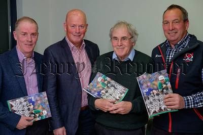 Pictured at the launch of Before I Forget, the journal of the Poyntzpass Historical Society. From left: Don Ferris, Bill Ferris, Frank Watters and John Best. The four men feature in a 1993 photograph on this years front cover  with a Poyntzpass Mini Rugby team containing  local Rugby legend Rory Best. Photograph: Columba O'Hare