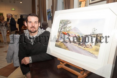 Anthony Highes who was the lucky winner of this painting in a raffle held on opening night. R1744004