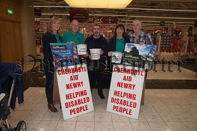 Pictured at the Quays are Chernobyl Aid Newry who are selling 2018 Calendars until this Saturday 16th December at 2 for £5. Pictured are Claire Connolly, Desmond McDonald, Jacinta Curran, Collie McGuigan and David Ellison from Discover Ireland who donated the calendars. The stand is located outside the internal entrance to Sainsburys from 2-9pm until 6pm Saturday. R1750002