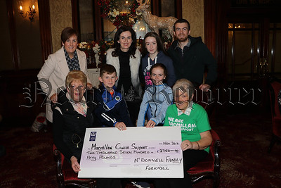 MCDONNELL FAMILY FORKHILL PRESENT CHEQUE TO MACMILLAN CANCER SUPPORT