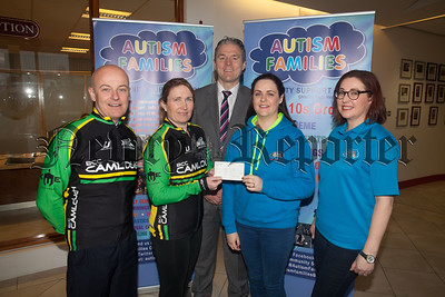 Camlough Cycling Club present a cheque to Autism Families for £3000 the proceeds of their Annual Cycling Sportive. Pictured with St Paul's High School Principal Jarlath Burns are Gerry Boyle and Tracy Finnegan From Camlough Cycling Club along with Ciara Fleminhg and Kelly Watson from Autism Families. R1812003