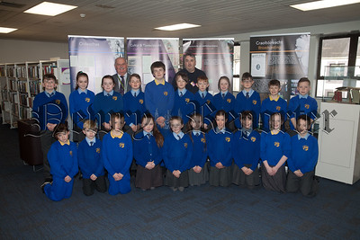Seamus MacDhaibheid and  Chris Cassidy from Newry Library are pictured with Primary 6 and 7 pupils. R1814005