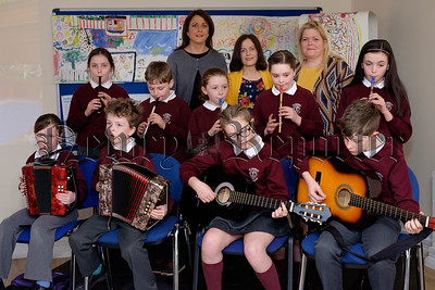 Pupils from St Patrick's Primary School, Crossmaglen provide the entertainment at the final Building Cultural Bridges Programme event in Newry and Mourne Co-Operative and Enterprise Agency. Also included are Eleanor Cassidy and Micheline McCreesh from St Patrick's and Pauline Coghlan, Building Cultural Bridges Programme. Photograph: Columba O'Hare/ Newry.ie