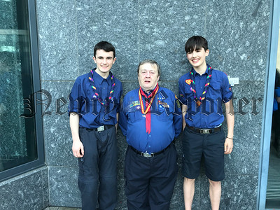 Scouts Joseph McEvoy and Conor Burns from First Dromore Newry pictured with Brian Boru County Commissioner Joe Corey outside Scouting Ireland's National Conference in Dublin on Satruday, after being presented with their National Scout neckerchiefs from the Chief Scout Christy McCann.