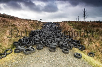 "© NewRayPics.com  01  Jan {ipt999cyear4} Northern Ireland For as far as the eye could  see , Over 1,000 used tyres were dumped in bogland high up on the mountain road leading to Clermont Cairn at Edentubber, Ravensdale Co Louth , less than a mile from the border .   This is an on-going problem with dumping at this remote area.  The dumping of Hundreds of Tyres  at a beauty spot in north Louth has been branded ""a disgrace"".  Everything from household rubbish to tyres have been dumped here over the last 20   years.    We would  ask the public to contact Louth County Council's litter hotline at 1800 20606 if they come across illegal dumping.  picture Newraypics.com"