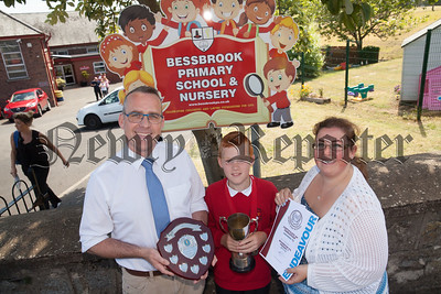 Bessbrook PS end of year awards. Pictured with Principal Larissa Hunterand Richard Melaniphy from Newry High School is Ryan Hamilton who won the Newry High School Endeavour Award. R1826015