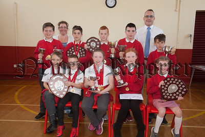 Bessbrook PS end of year awards. Pictured with Principal Larissa Hunter and Richard Melaniphy from Newry high is the Newry high School Sport Achievement Award winners. R1826014