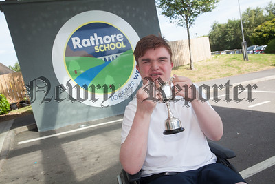 Ciaran Finn-Lynch a pupil at Rathore School newry is pictured with his award My Music cup which he was given during a presentation at Craigavon Civic Centre. R1826016