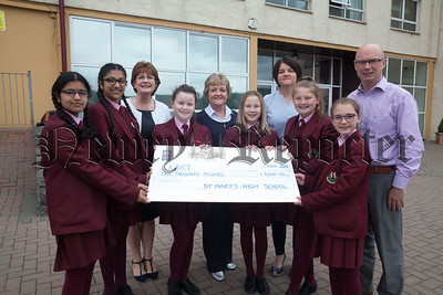 Year 8 pupils from St Mary's are pictured with Eithne Bell from KBRT presenting a cheque for £1000 money raised through various charity events which took place throughout the school year. Also pictured is Principal Margo Cosgrove, Denise Crawley and Maurice Fitzpatrick. R1826005