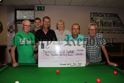 ARMAGHDOWN POOL TEAM AND LOTTO CLUB PRESENT CHEQUE TO MACMILLAN CANCER SUPPORT