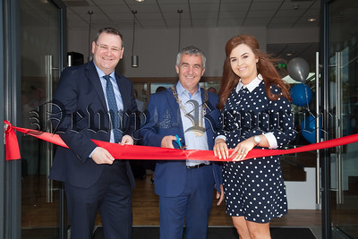 Jonathan McKeown and Colleen O'Hare pictured with Chairperson Mark Murnin at the opening of Granite Exchange. R1826009