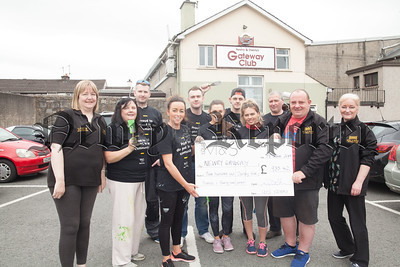 Staff from Marks and Spencer Newry pictured with volunteers from Newry Gateway Club presenting a cheque for £935.42 money raised through staff donations in thei canteen. Marks and Spencer staff also lent a hand in re decorating Newry Gateway club during Charity Week. R1826002