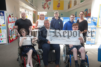 RATHORE SCHOOL GIVES BACK BY SUPPORTING PIPS HOPE AND SUPPORT Pictured this morning is Rathore School Principal Caroline Currie and Vice-Principal Jim O'Hare along with pupils presenting PIPS Hope and Supports Community Fundraiser Padraig Harte with a cheque for £1,349.27. The school, parents and staff wanted to 'give back to the community' as a way of showing their appreciation for their own fundraising achievements over the years which has allowed the school to avail of a number of new opportunities themselves. The staff shortlisted a number of local charities and individually voted on the charity to be chosen. All involved arranged a number of innovative events to raise much needed funds for PIPS Hope & Support, these included; coffee mornings, Valentine's discos and Green Days at St. Patrick's Day to name a few. R1826017