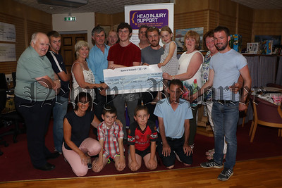 GARY MCNAUGHTON MEMORIAL FUND PRESENT CHEQUE TO HEAD INJURY FUND