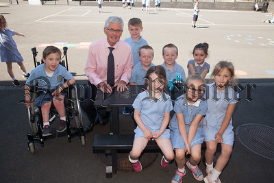 John Campbell pictured with pupils at St Peter's Cloughreagh. R1827008