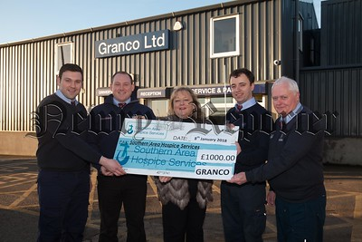 Fiona Stephens from Southern Area Hospice accepts a cheque from Kieran McCartan, aaron Grant, Kevin Martin and Seamus Byrne from Granco for £1000 money raised through Christmas Jumper Day and Customer donations. R1803001