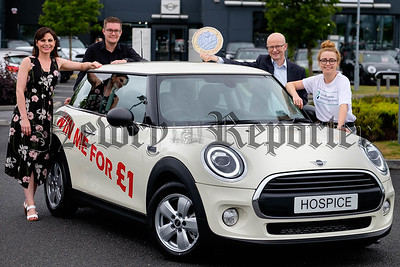 Win a Mini for £1 -  Suzanne Curtis, Autoline; Mark McKelvey, Prentice;  Peter Murray, Buttercrane Shopping Centre and Amy Henshaw, Southern Area Hospice Services, reminding everyone that tickets are now on sale for the Southern Area Hospice 'Win a Mini' draw. Photograph: Columba O'Hare/ Newry.ie