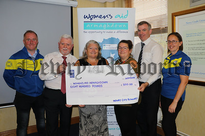 NEWRY CITY RUNNERS PRESENT CHEQUES TO CHARITIES