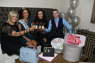 A toast to many years of business in Bennett's Boutique in the special room set aside for personal shopping and Paula Loughran, Niamh Rocks and Paul Edmond Rocks show Kirsten Mate-Maher a selection of gifts available. R1839218