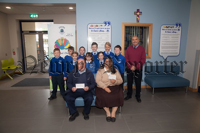 Pictured are School Council members from St Clares Abbey PS handing over cheques to Mr Colin Bell from KBRT amd Sister Cruz from El Salvador. At the beginning of every year the pupils choose which charities they are go to help and then organise fundraisers. R1839013