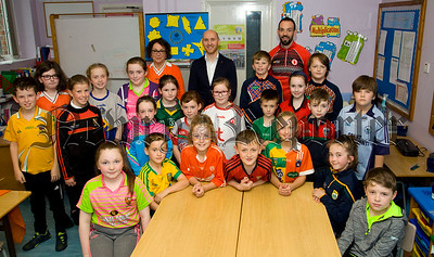 Down GAA Managaer Paddy Tally pictured with children from Primary 6/7 at the Bunscoil an Iuir on Friday when he called to talk with them about Health and Well Being. Also pictured are Paraic O Mairtin, Principal and Siobhan Jackson, teacher.  R1841014