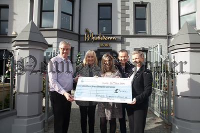 Denise Doyle from Southern Area Hospice accepts a cheque for £3000 the proceeds of the Fergal Flaghterly annual Music Night held in the Whistledown Hotel Warrenpoint. Also pictured are Desy and Sharon Goss, Colum McAvoy and Bernie Lively. R1843005
