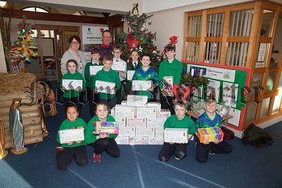 Patrick Loughran from Rotary Club Newry is pictured with members of the St Ronan's School Council who took part in the Annual Rotary Club Christmas Shoebox Appeal. R1849003