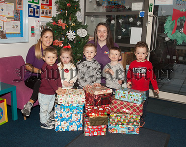 Pictured are Terri Quinn and Nicole McKenna with some of the children at Puzzles Childcare who took part in the Christmas Shoebox Appeal in aid of Newry Helping the homeless. R1851005