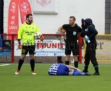 Stephen Teggart lies injured following a bad Benny Ugiehon tackle just 20 seconds after the start of the match.