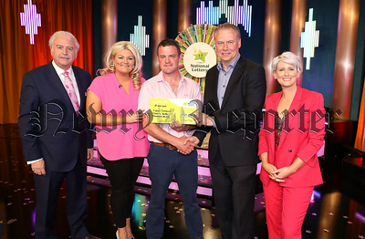 Kieran Connolly from Gladybeg, Co. Armagh has won €27,000 on last Saturday's (11th May 2019) Winning Streak Game Show on RTE. Pictured here at the presentation of the winners cheques were from left to right: Marty Whelan, Winning Streak game show co-host; Tanya Connolly, the winning player who played on behalf of her husband Kieran; Kieran Connolly the winning recipient; Dermot Griffin, Chief Executive of the National Lottery and Sinead Kennedy, Winning Streak Game Show co-host. The winning ticket was bought from Applegreen, Old Newry Road, Dundalk, Co. Louth.  Pic: Mac Innes Photography