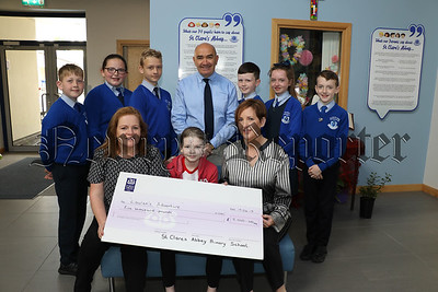 ST CLARE'S ABBEY PRIMARY SCHOOL PRESENT CHEQUE TO LAUREN FITZGERALD