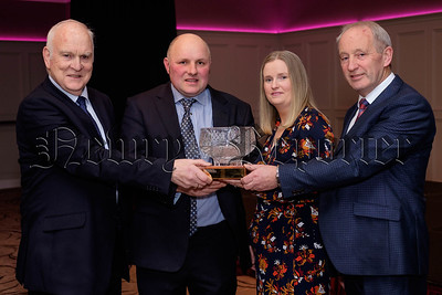 Philip and Sandra McCartney, Jerrettspass were the winners of the Co Armagh Ulster Farmers Union, Spring Barley Competition and are pictured receiving their crystal trophy from Kenneth Hill, left, Chairman, Co Armagh UFU and David Johnston, Loughgall. Photograph: Columba O'Hare/ Newry.ie