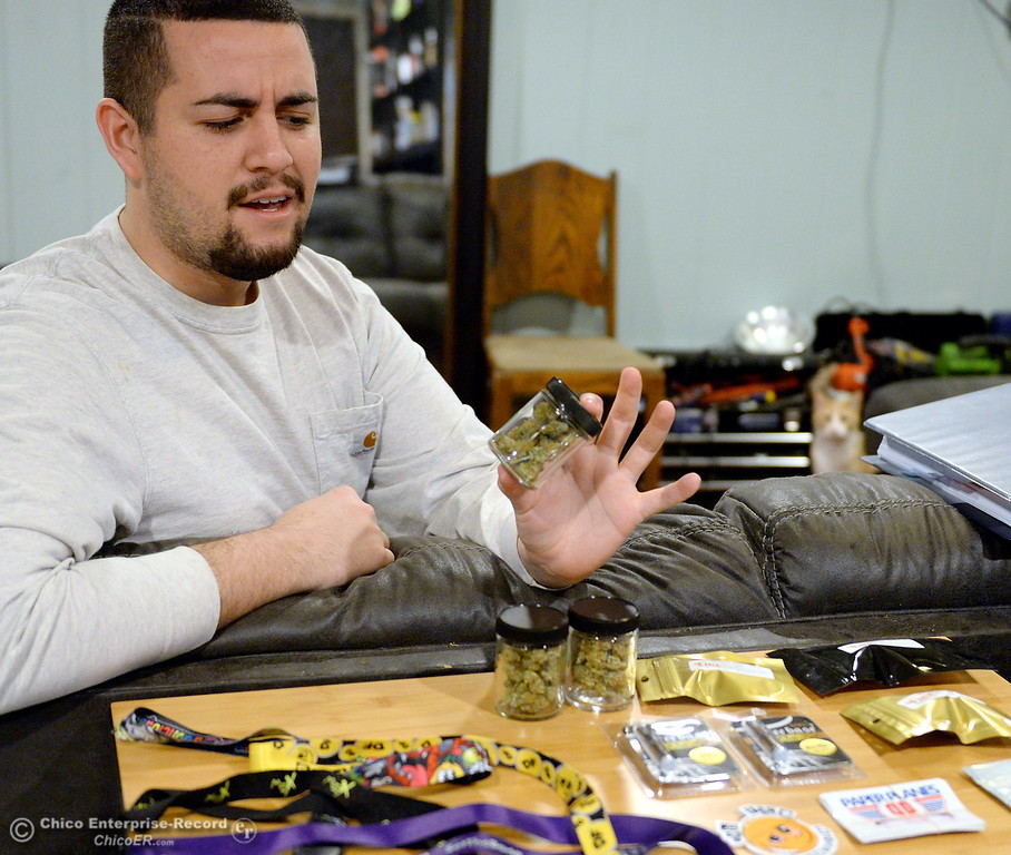 . Former Cannabis dispensary/delivery owner Samuel Monteon holds a sample as he talks about the industry and the hopes he has for change during an interview at his Chico, Calif. home Mon. Jan. 8, 2018.  (Bill Husa -- Enterprise-Record)