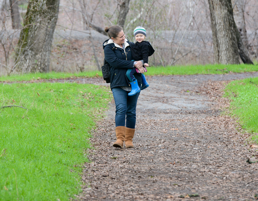 . Stephanie Plummer and her son, Miles go for a walk around Five Mile Recreation Area Wednesday January 10, 2018 in Chico, California. (Emily Bertolino -- Enterprise-Record)