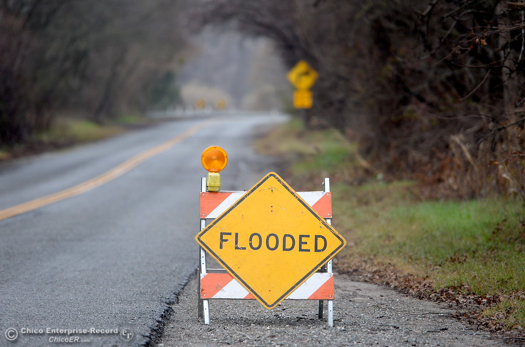 . A flooded sign is seen along River Road in Chico, Calif. Wed. Jan. 10, 2018. The road was open with no flooding Wednesday.  (Bill Husa -- Enterprise-Record)