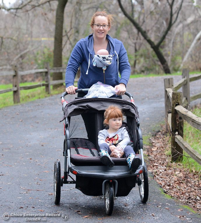 . Sara Darr takes Daisey, 2, and Oliver, 1 month, for a walk through Five Mile Recreation Area Wednesday January 10, 2018 in Chico, California. (Emily Bertolino -- Enterprise-Record)