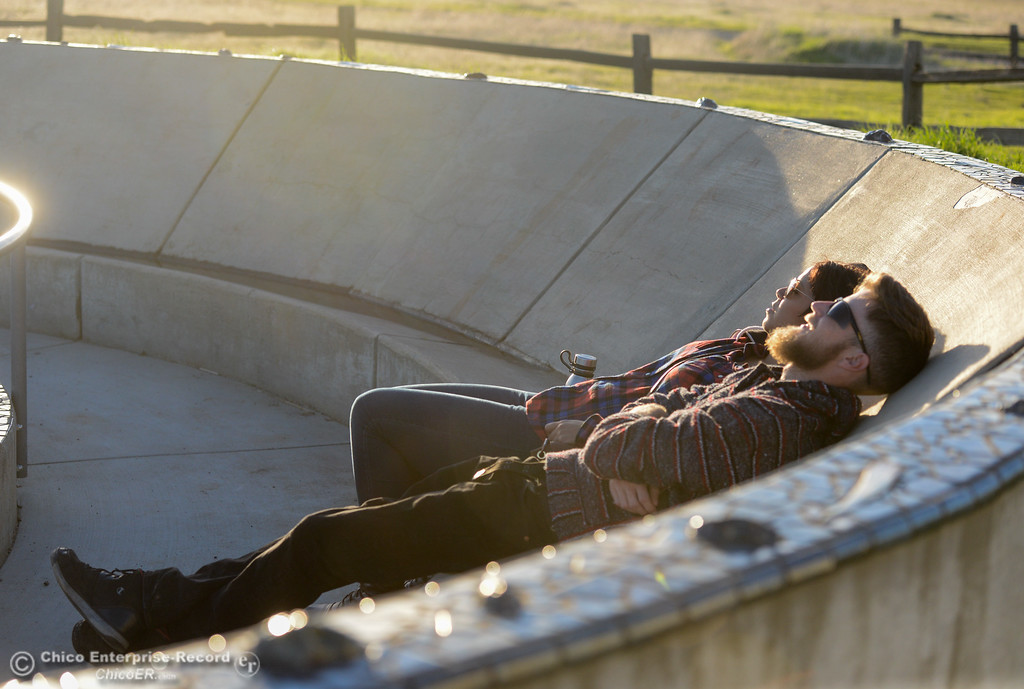 . Leanna Uribe and Bryan Swift bask in the sun at the Chico Community Observatory Friday January 12, 2018 in Chico, California. (Emily Bertolino -- Enterprise-Record)