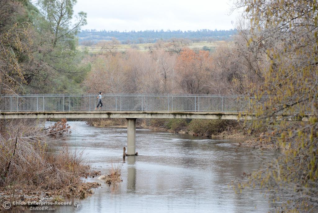 . A jogger crosses the bridge over Big Chico Creek at Five Mile Recreation Area Wednesday January 10, 2018 in Chico, California. (Emily Bertolino -- Enterprise-Record)