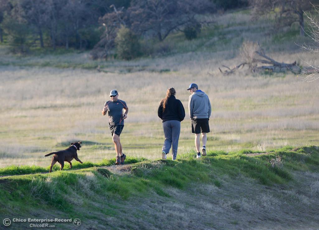 . People enjoy an afternoon walk around Horseshoe Lake Friday January 12, 2018 in Chico, California. (Emily Bertolino -- Enterprise-Record)