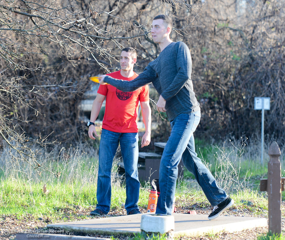 . Tyler Schafer watches as Antoine Ban Den Boogaard tees off at the Sherwood Forest disc golf course Friday January 12, 2018 in Chico, California. (Emily Bertolino -- Enterprise-Record)
