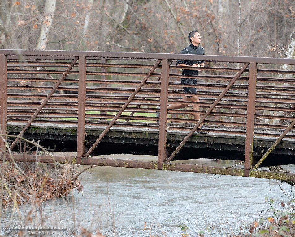 . A runner crosses a footbridge over Big Chico Creek in Chico, Calif. Wed. Jan. 10, 2018.  (Bill Husa -- Enterprise-Record)