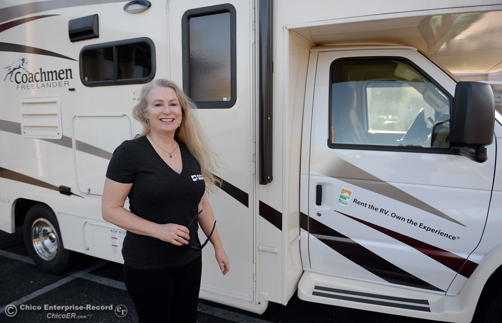 . Bonnie Worthington smiles beside an RV that is available through RV Rental Connection, a business that connects RV renters and RV owners Friday Jan. 12, 2018.   (Bill Husa -- Enterprise-Record)