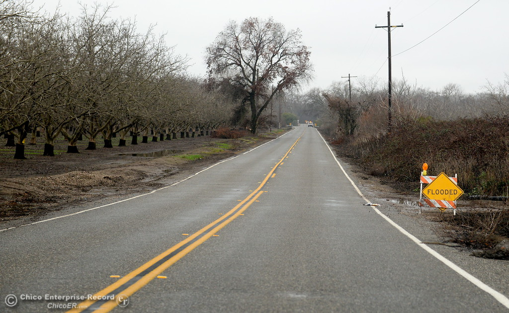 . A flooded sign is seen along W. Sacramento Ave. although the road is open in Chico, Calif. Wed. Jan. 10, 2018.  (Bill Husa -- Enterprise-Record)
