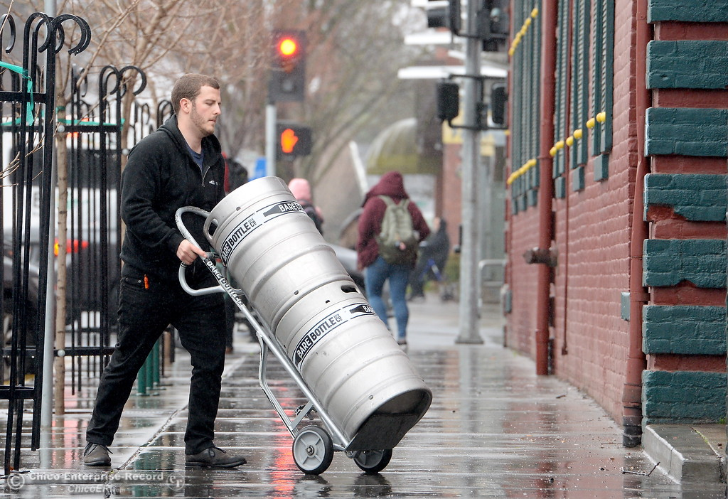 . A man with a hand cart wheels two kegs into the Madison Bear Garden while students roam around campus as the spring semester begins on the CSUC campus Monday Jan. 22, 2018. (Bill Husa -- Enterprise-Record)